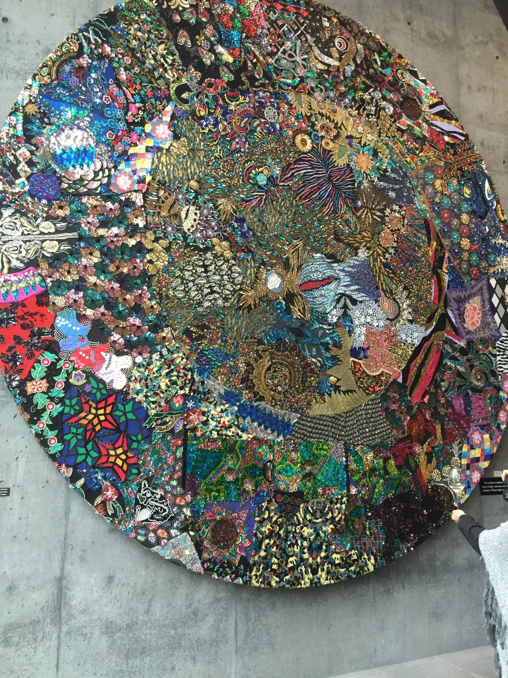 Medallion art piece in lobby at Hall Wines, by Nick Cave.