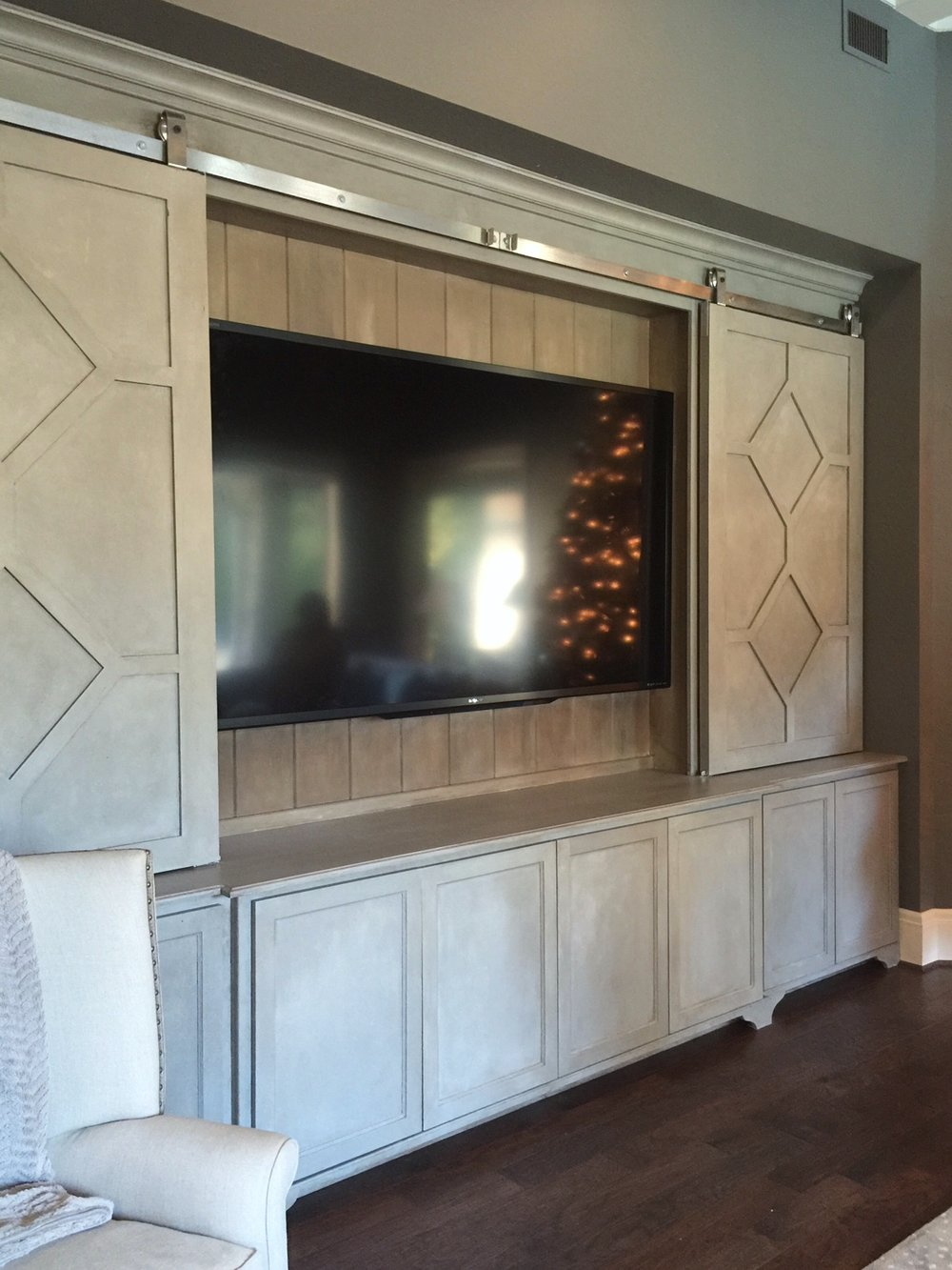 Large TV / Entertainment center with barn doors