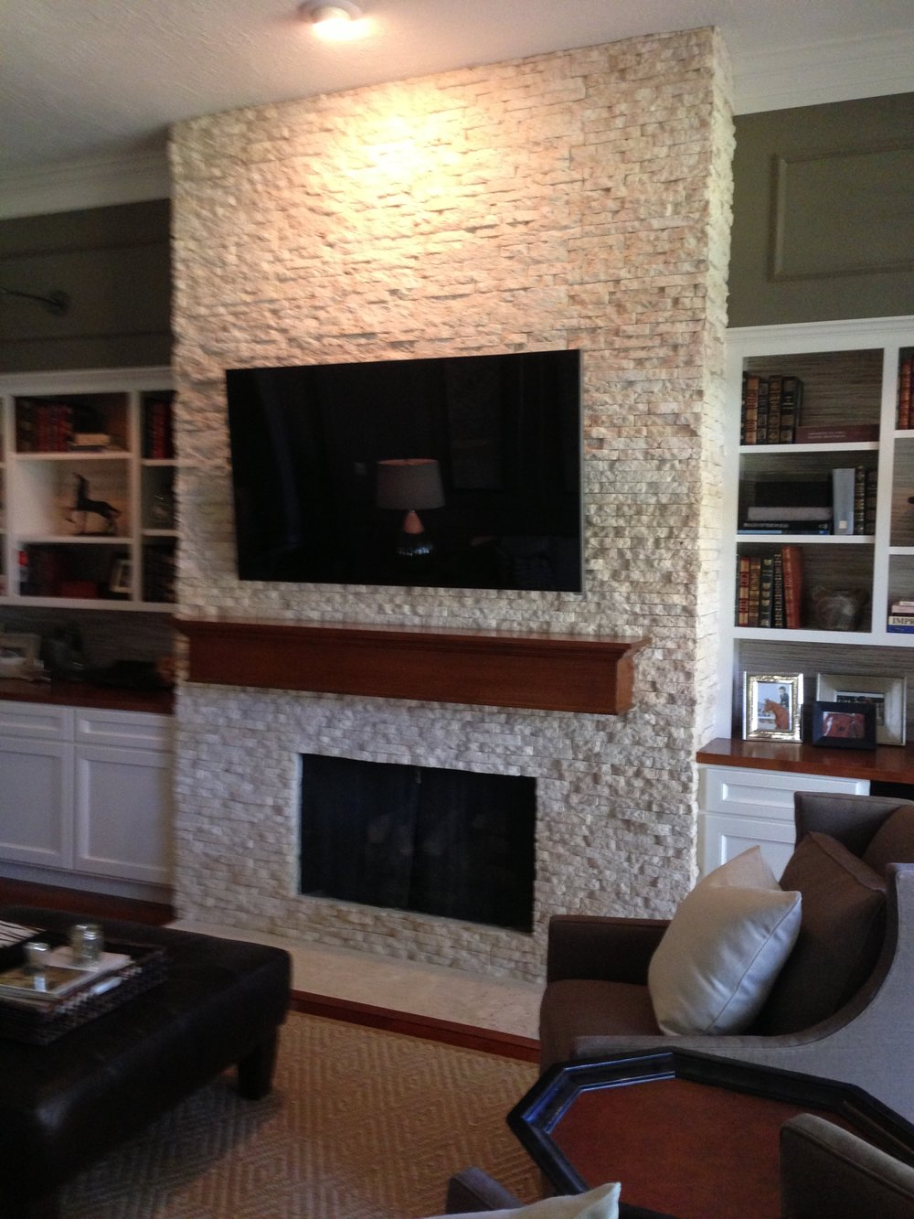 After  - Fireplace wall remodel w / tv mounted above