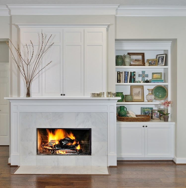 After - Fireplace wall remodel with tv above in cabinetry with bi-fold doors