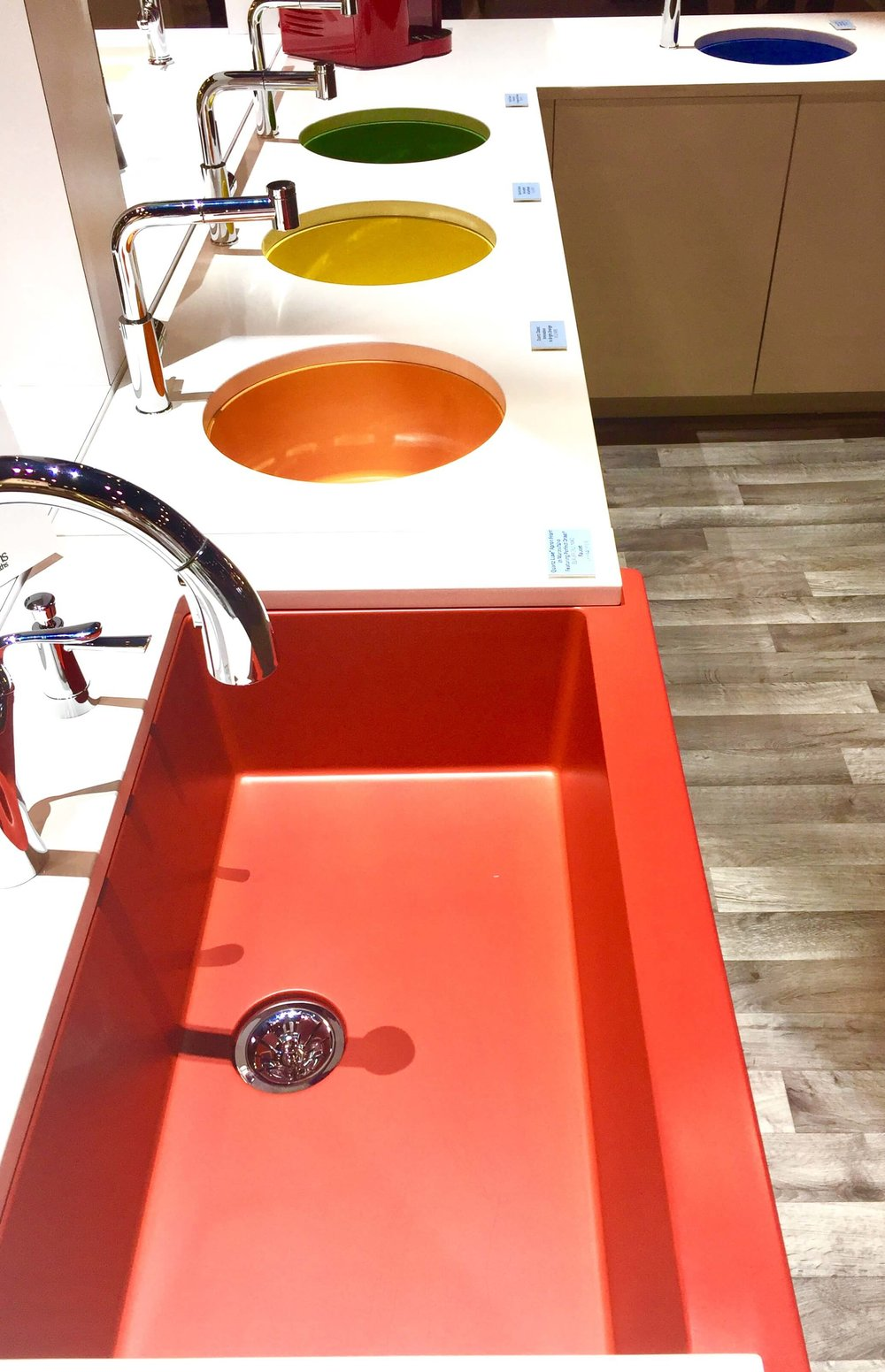 Bright colored sinks made a debut at Elkay.