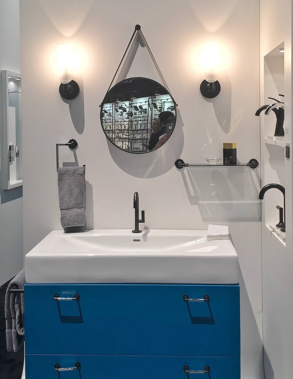 Jason Wu faucets and plumbing fixture line at Brizo on a blue floating cabinet