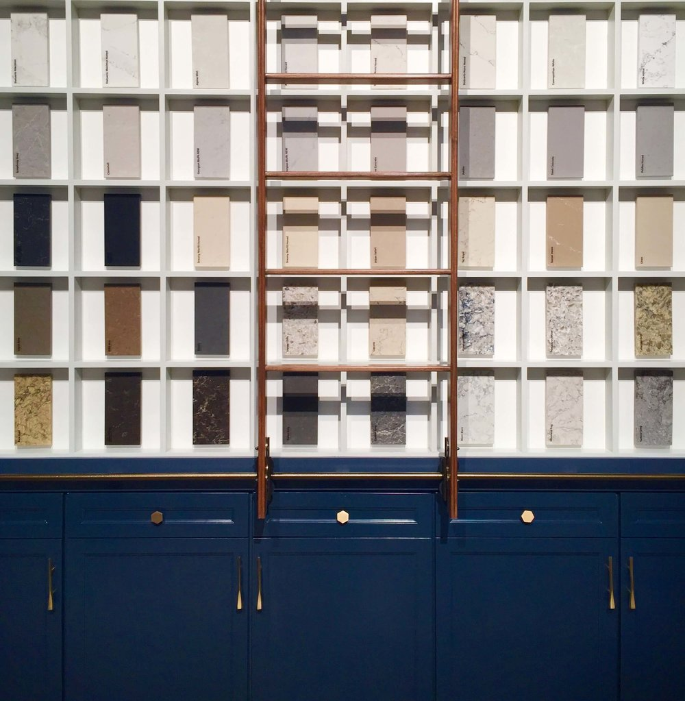 I loved this display from Caesarstone with the blue cabinetry, brass hardware and a touch of wood in that rolling ladder