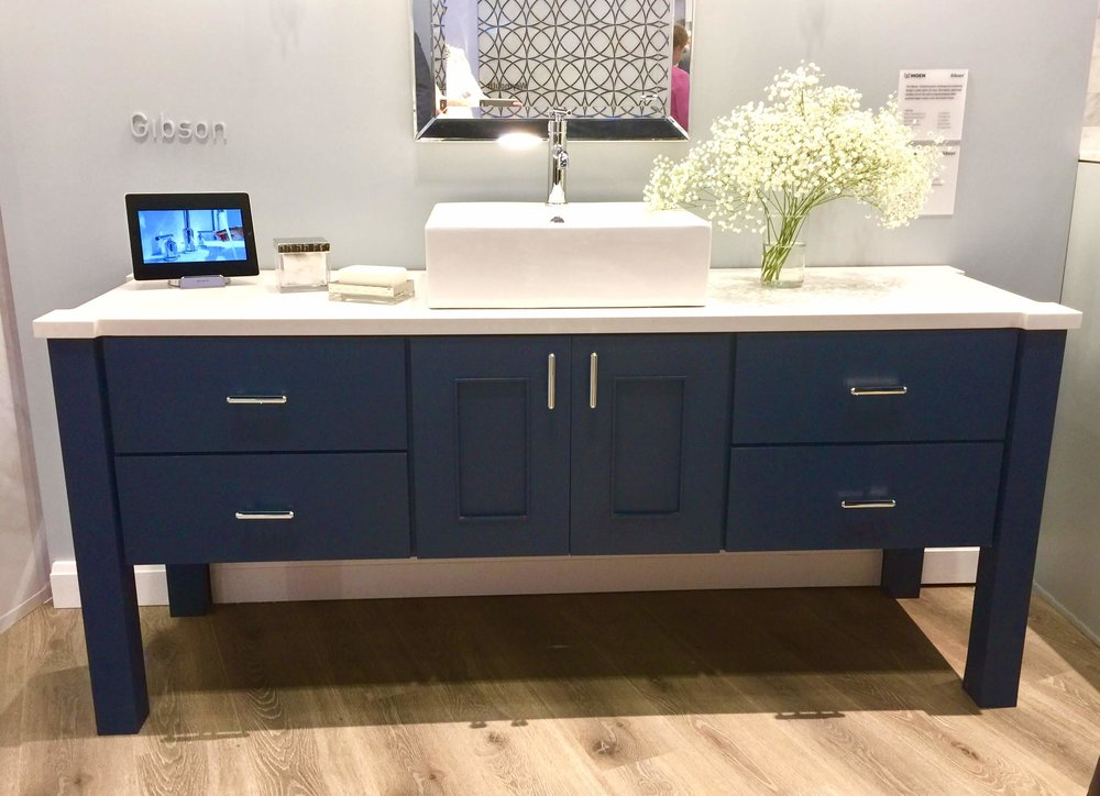 Love this look of a navy cabinet with crisp, white counter and sink. This beauty was at the Moen booth.
