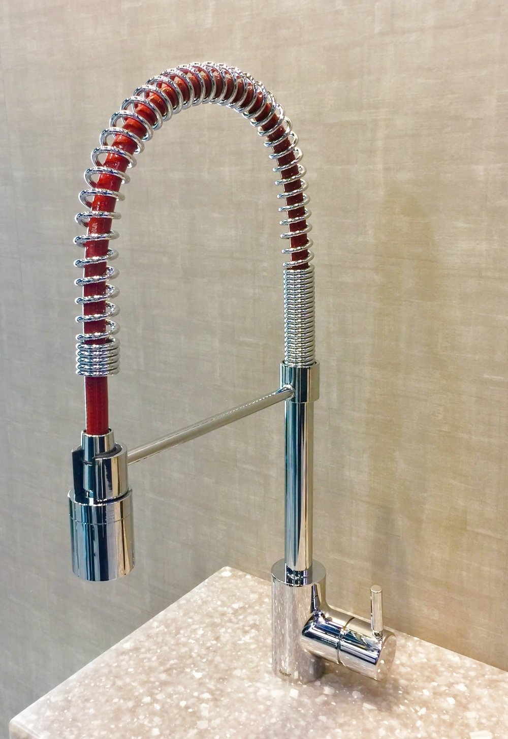 Danze faucet with a colorful, red hose