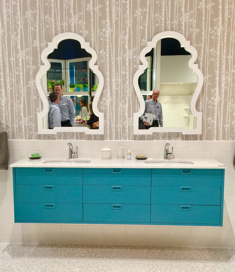 Colorful cabinet with white counters and backsplash in the Kohler booth