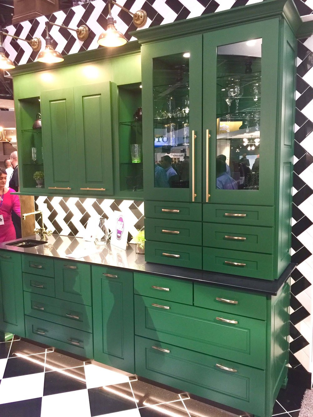Wellborn Cabinets emerald green color looked sharp with black, white, and brass.