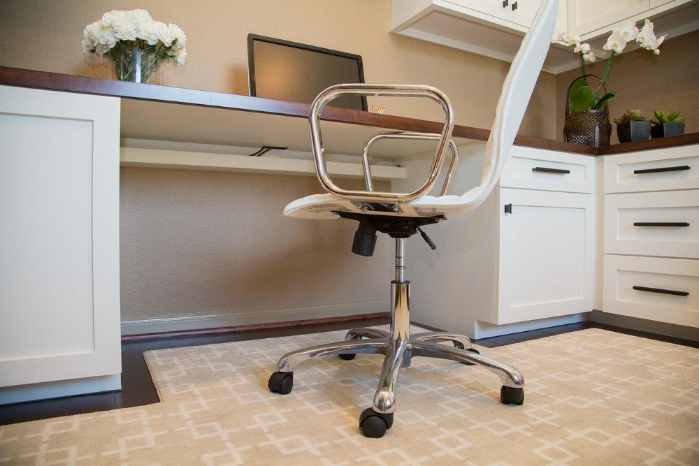 Home office built in desk with wire management shelf under desktop.