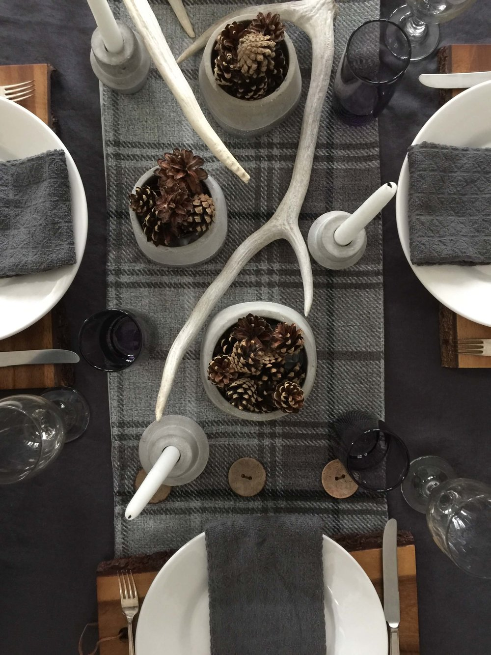 Winter tabletop decor in gray and white with wood cutting boards | Carla Aston