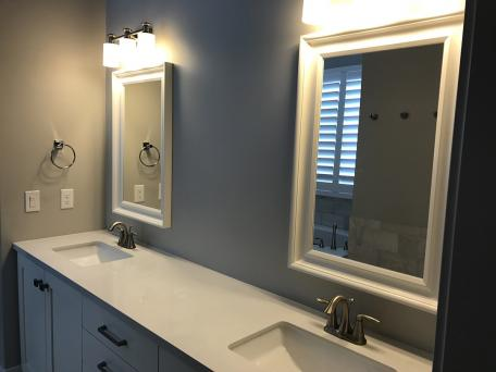 Popular Master bath with double sinks Tiling the back wall to the ceiling should she