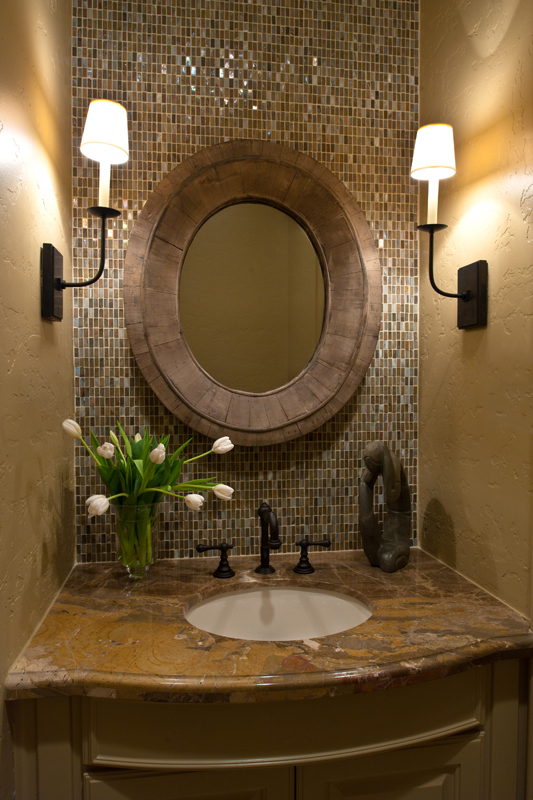 Elegant Bathroom vanity with no side splash Tiled wall from counter to ceiling has more impact