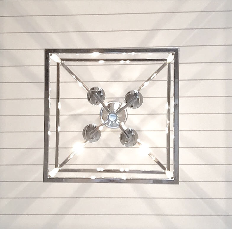 Modern shiplap on ceiling with polished nickel lantern fixture
