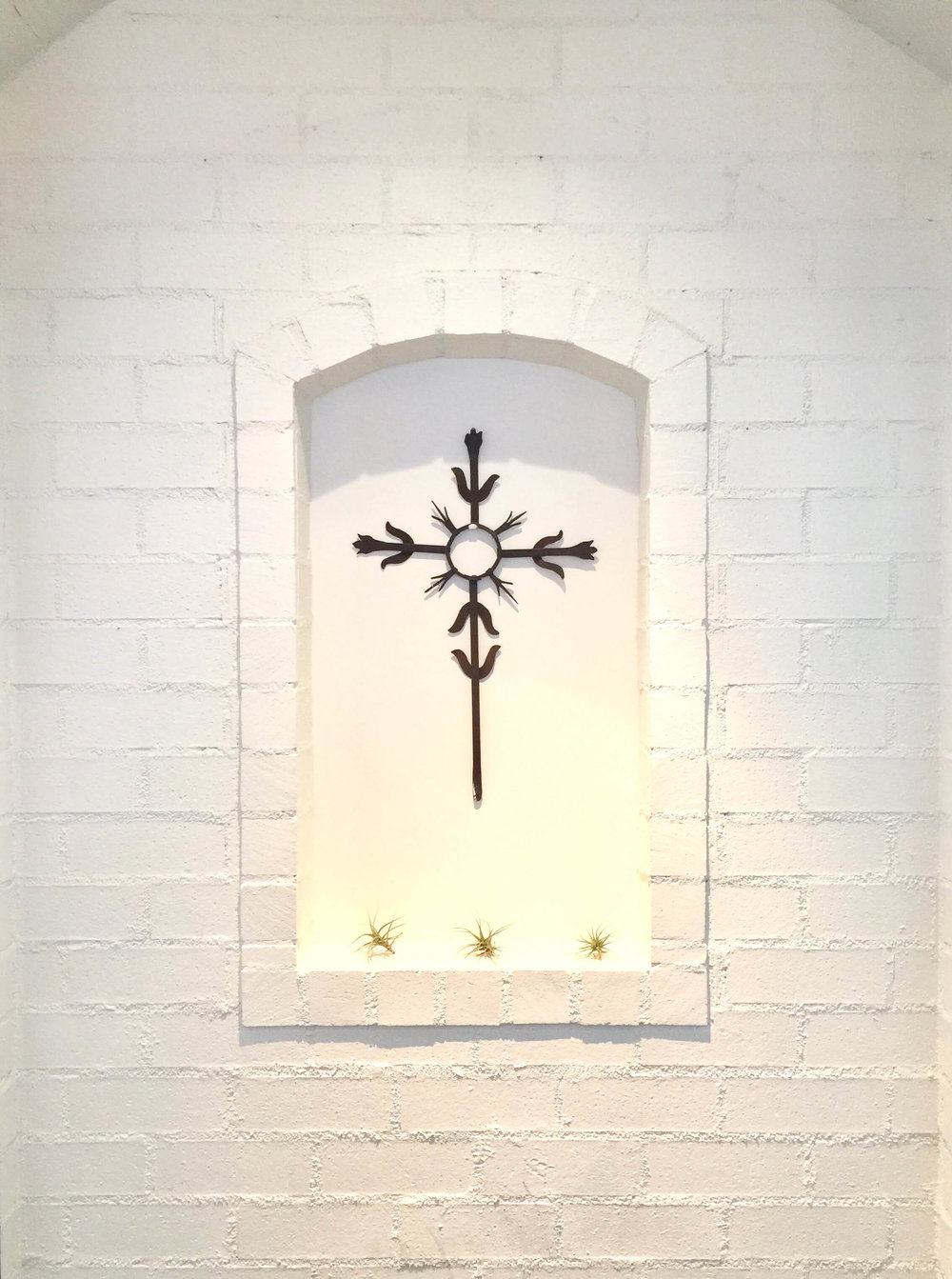 Wall niche decorated simply with painted white brick