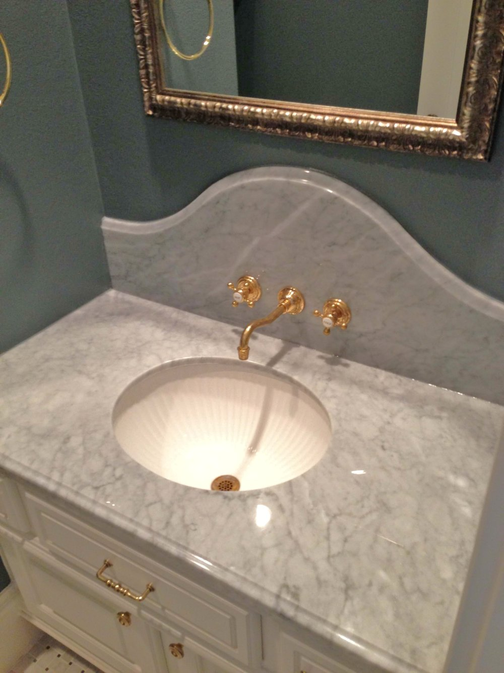 Gray bathroom with Carrara marble and brass | Designer Carla Aston