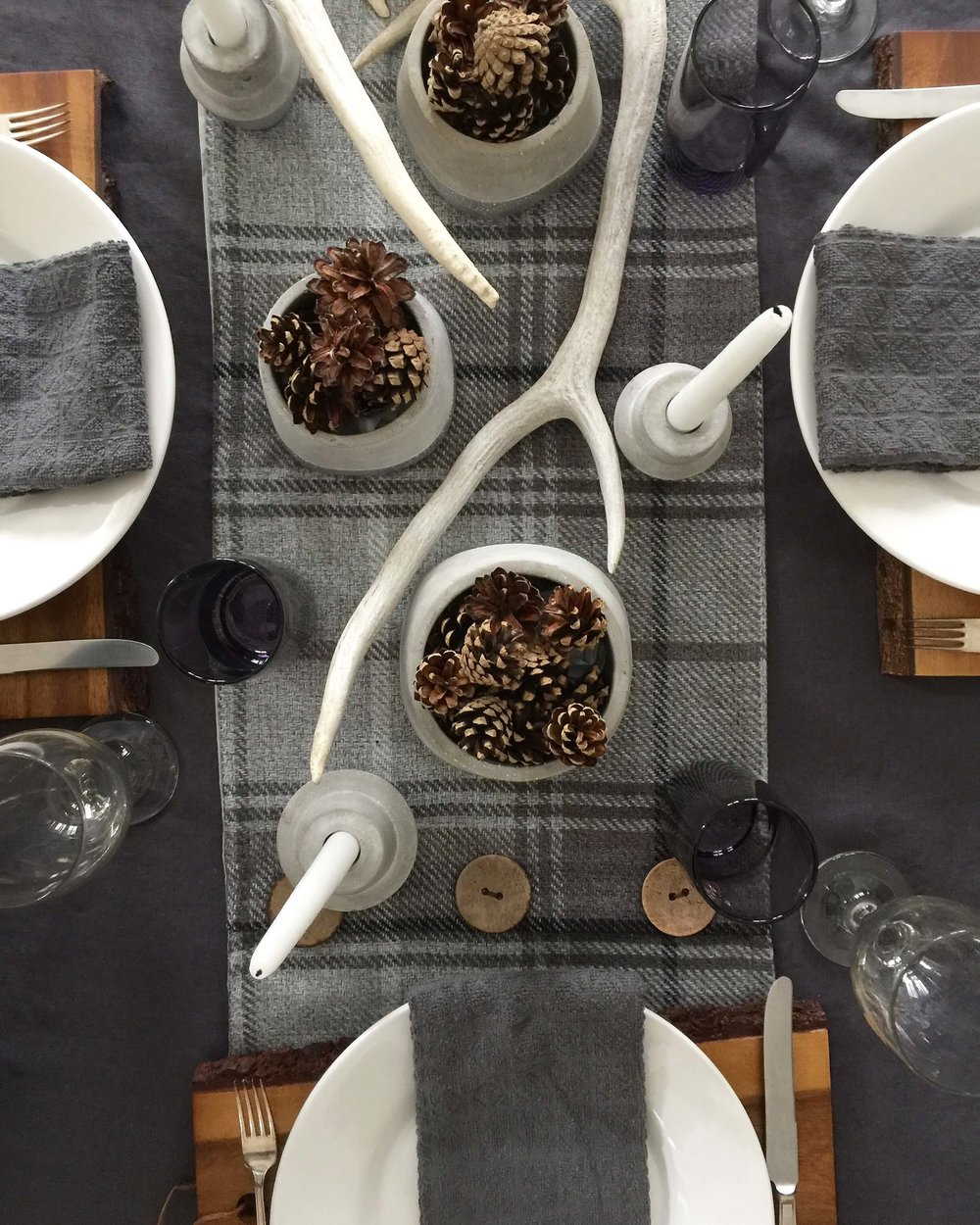 Gray and warm wood combined beautifully on  my winter tabletop  that uses walnut cutting boards as chargers | Carla Aston