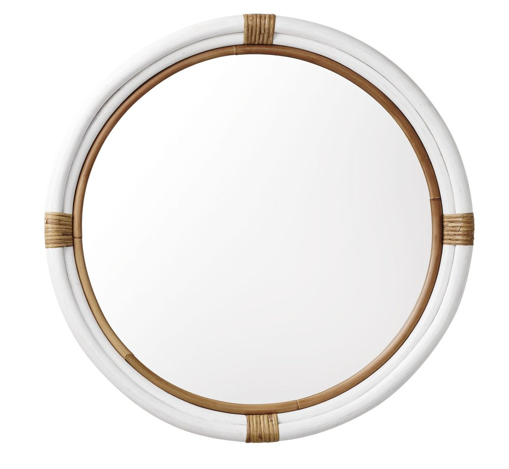 White round mirror with rattan trim