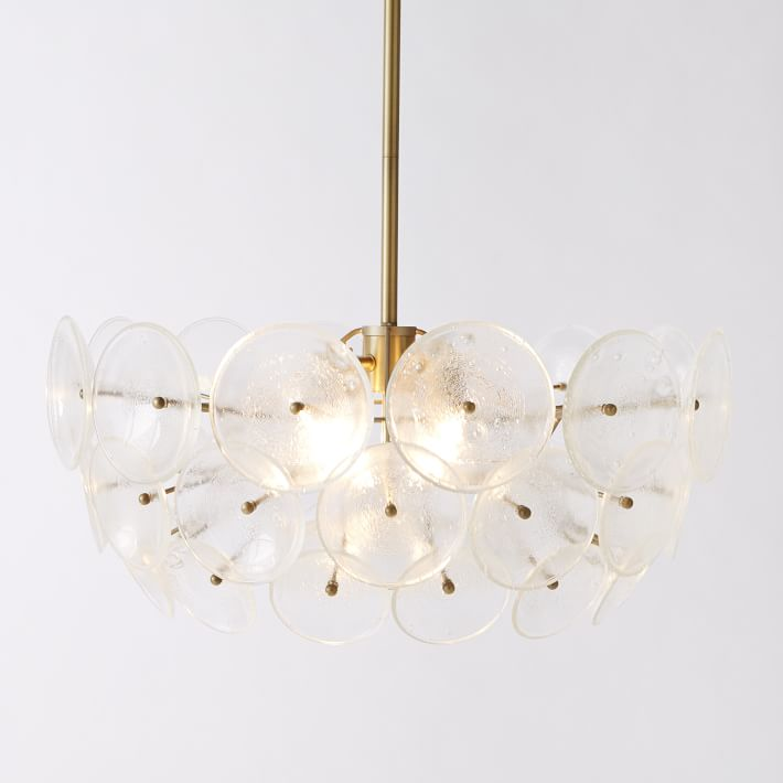 Brass pendant light fixture with glass discs