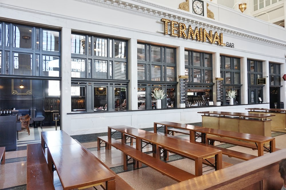 Wood tables and benches at the Terminal Bar in Union Station, The Crawford Hotel, Denver