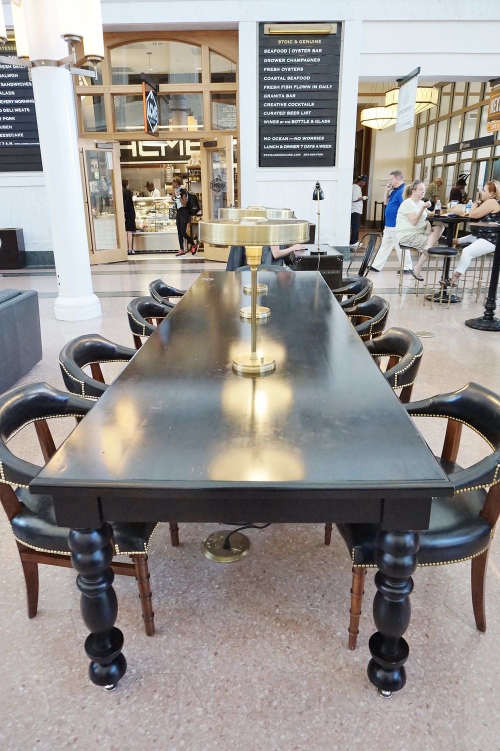 Library tables with brass desk lamps | The Crawford Hotel | Union Station | Denver