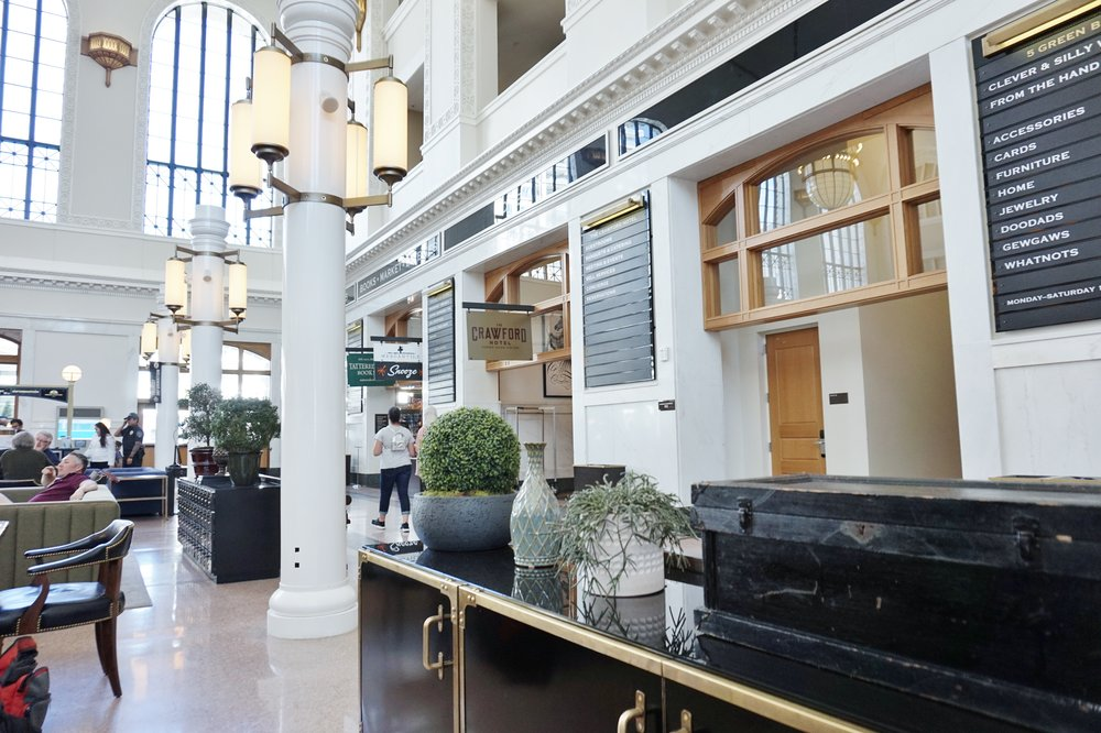 Trunks and campaign style furnishings accent the seating groups in The Crawford Hotel | Union Station | Denver