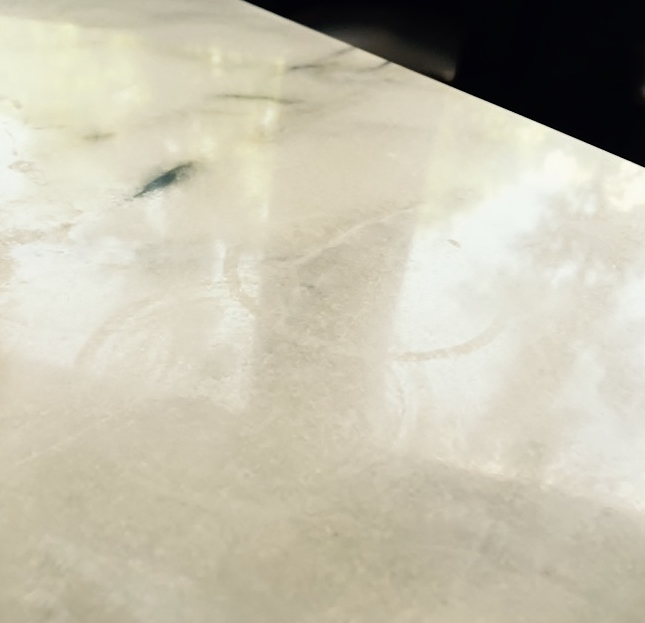 See the etched rings on this restaurant marble tabletop?