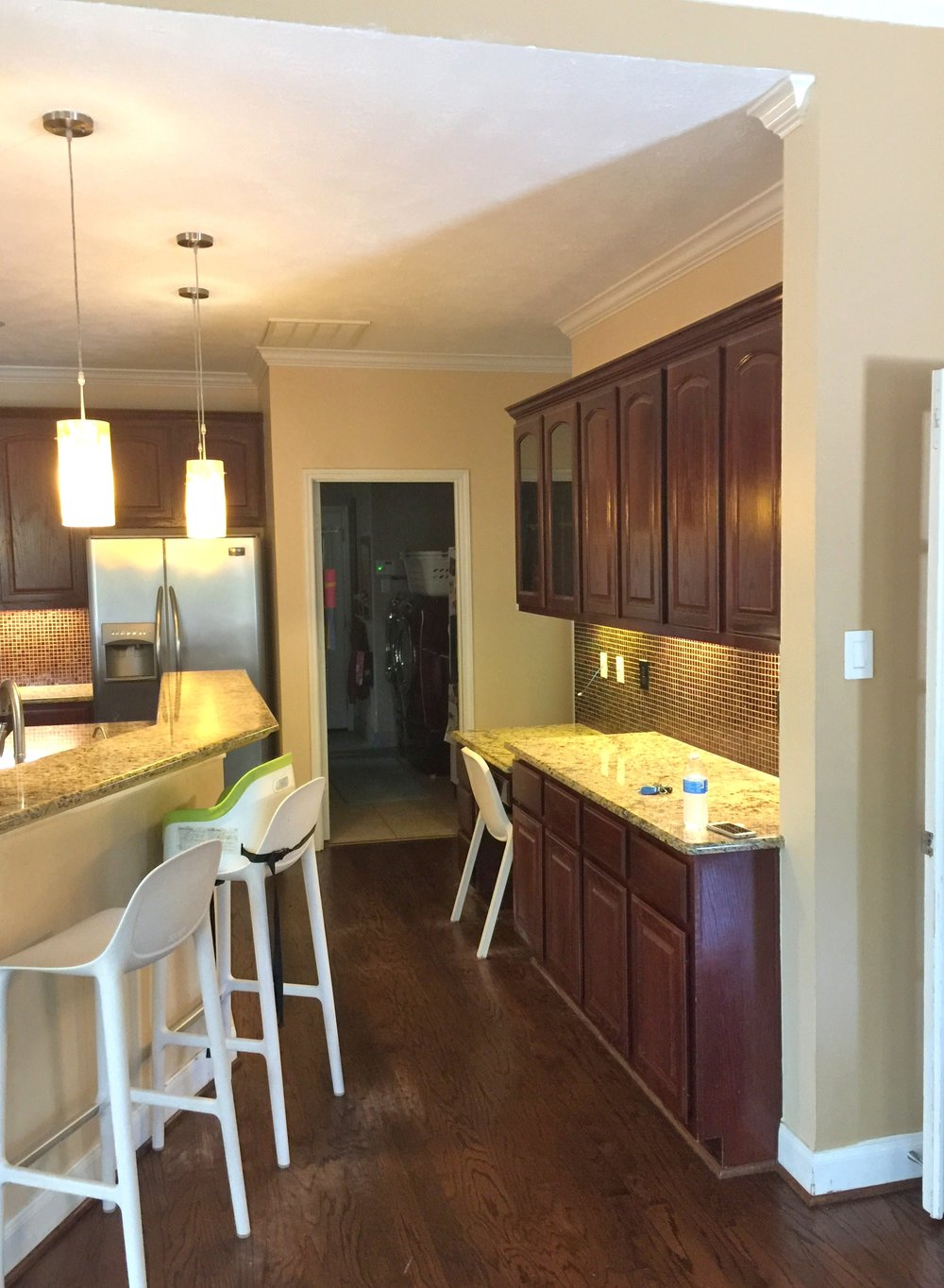 Before - kitchen remodel with small desk and builder standard cabinets above
