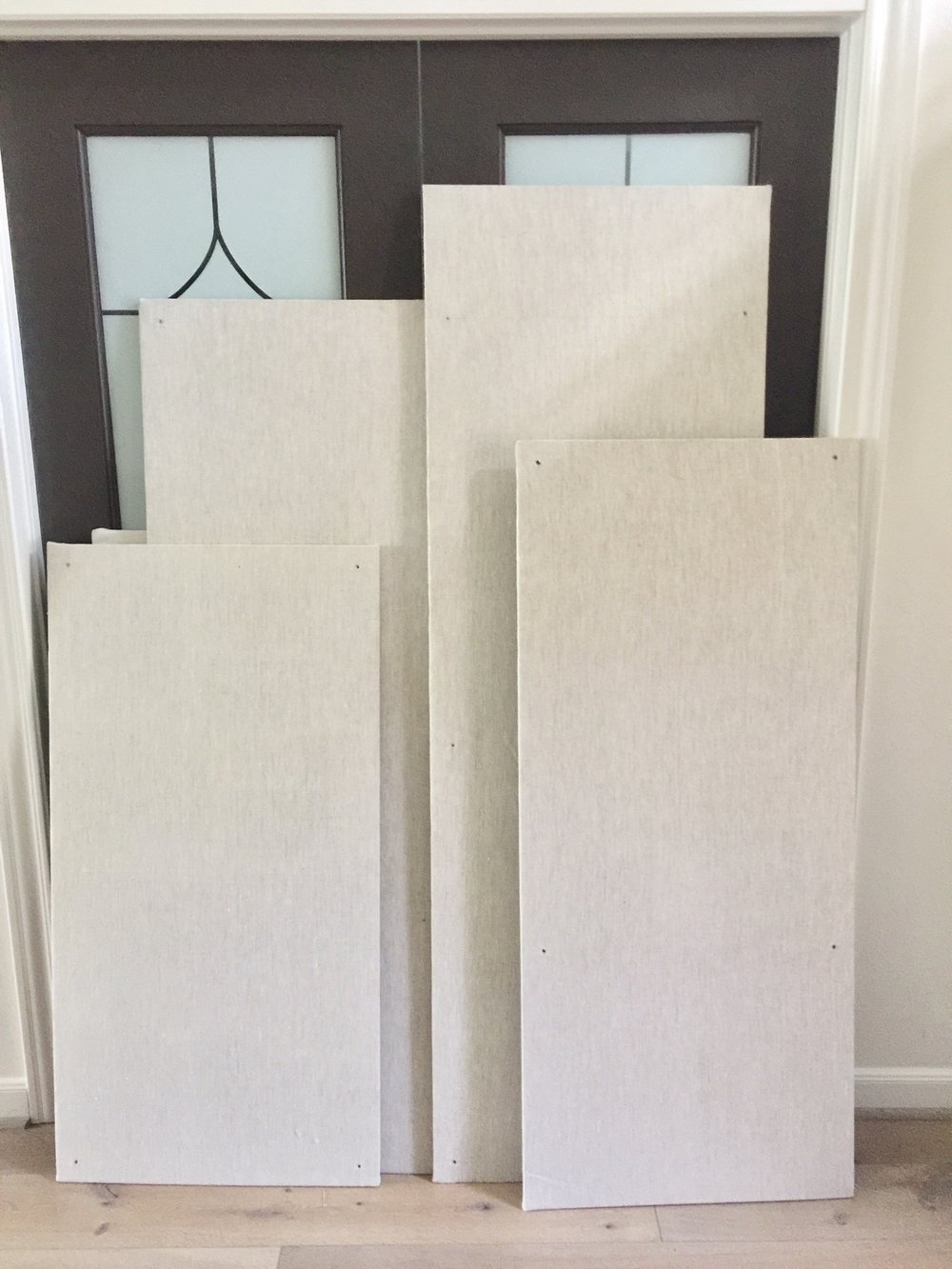 "Natural linen covered homasote tackboards - 24"" x varying lengths, all at $20 ea."