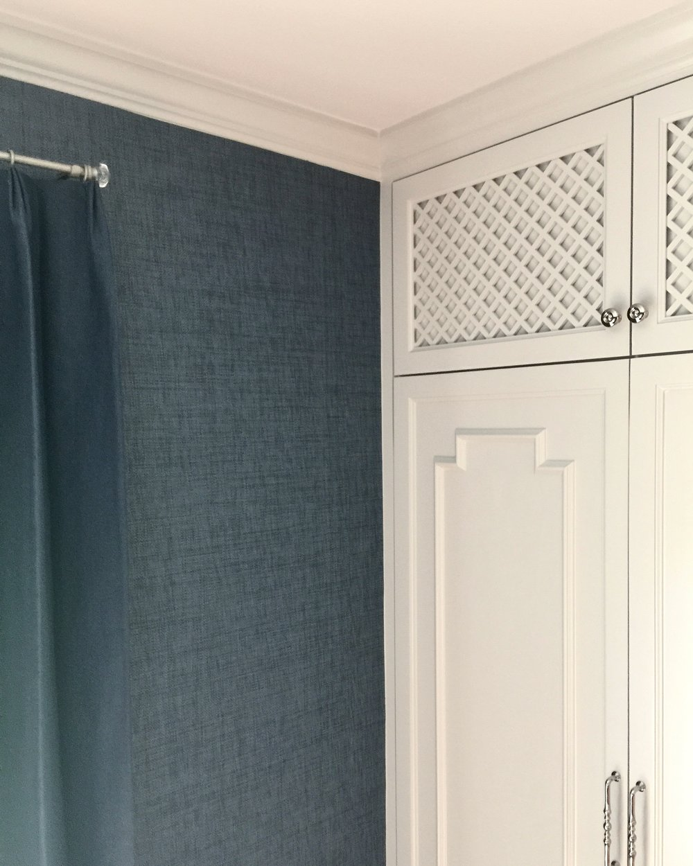 Navy grasscloth with chinoiserie style cabinet onlay design - Designer: Carla Aston