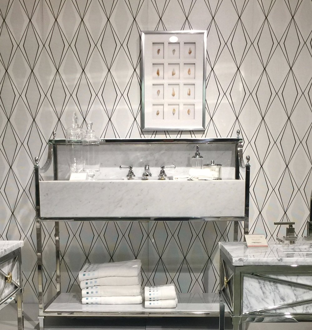 Love the white marble and polished stainless look of these bathroom vanities from Ambella Home.