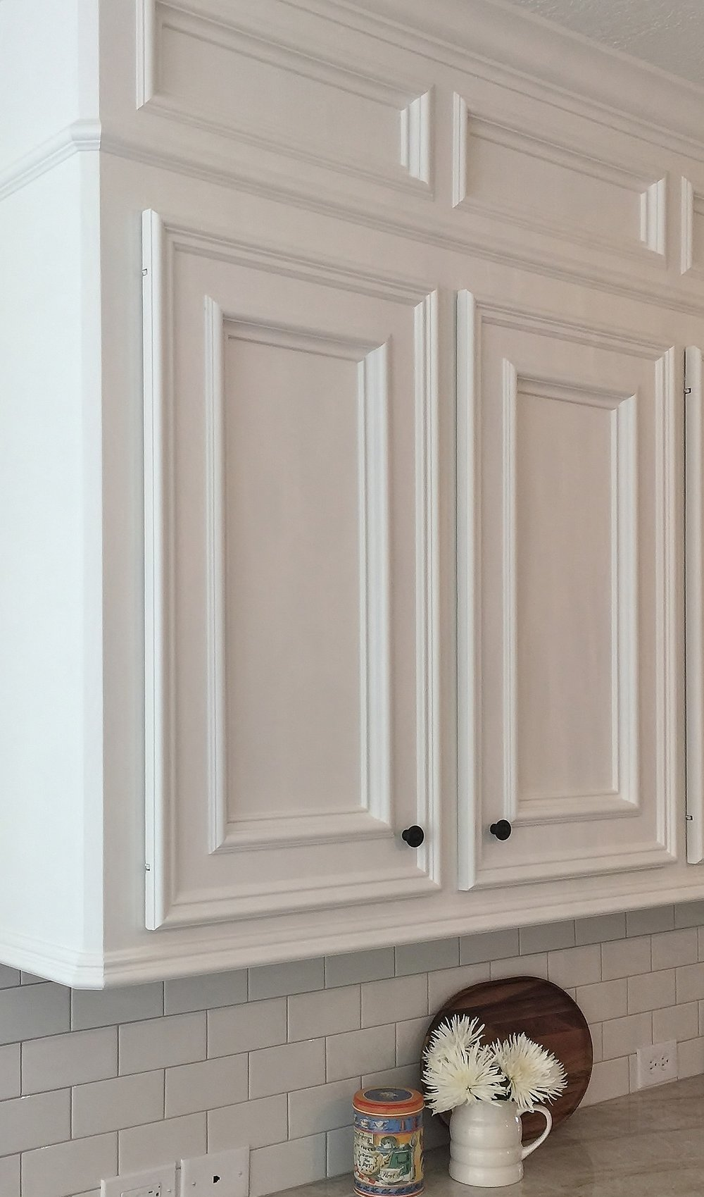 Knife hinges were used here to replace the very old, dated exposed hinges on this existing cabinetry.