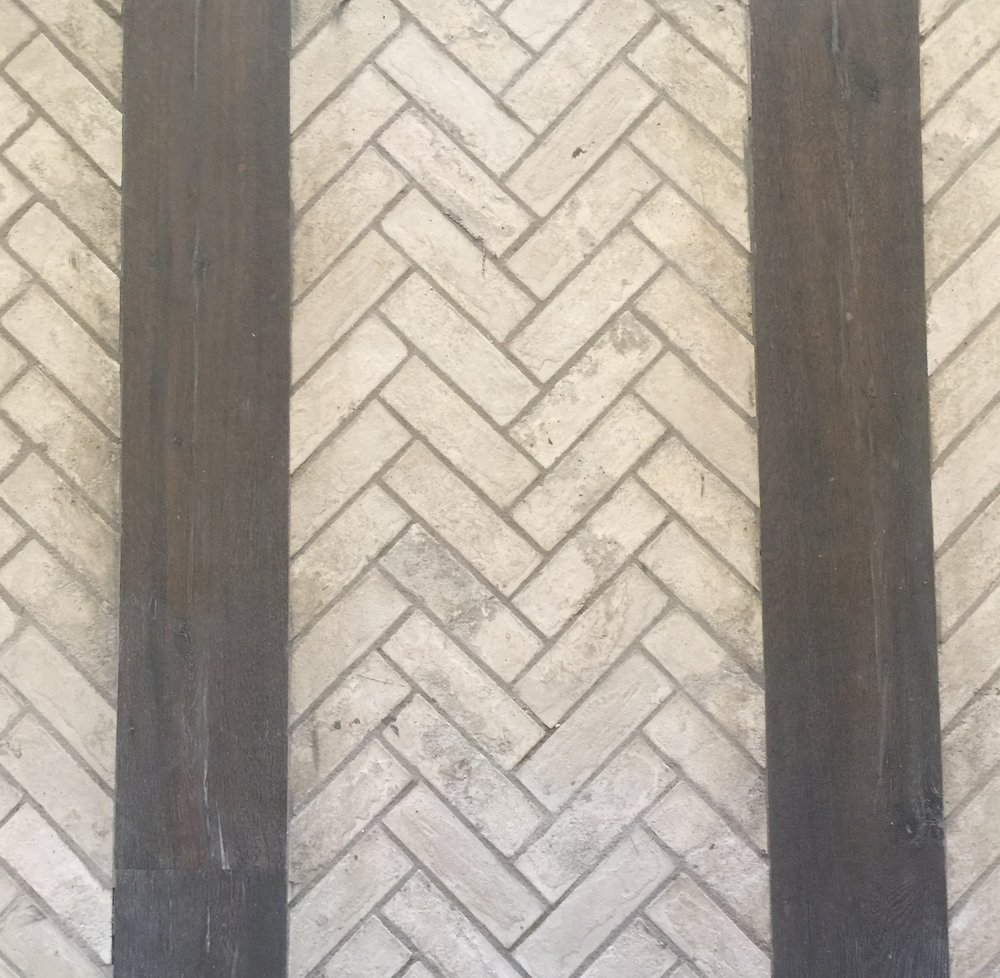 Herringbone brick floor with rustic wood in Entry Hall - Designer Teena Caldwell
