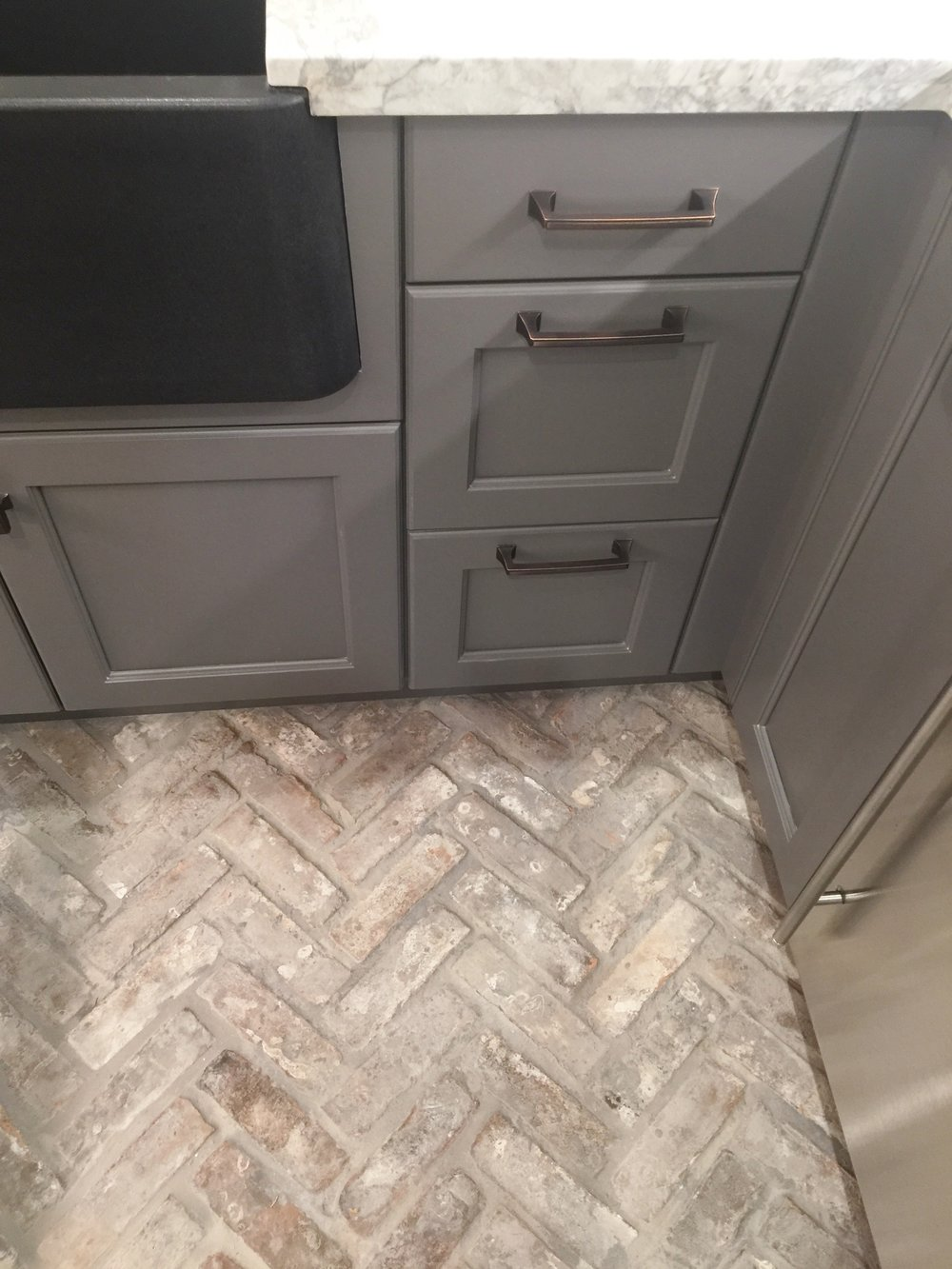 Brick flooring in the butler's pantry - Designer Jamie Haskins