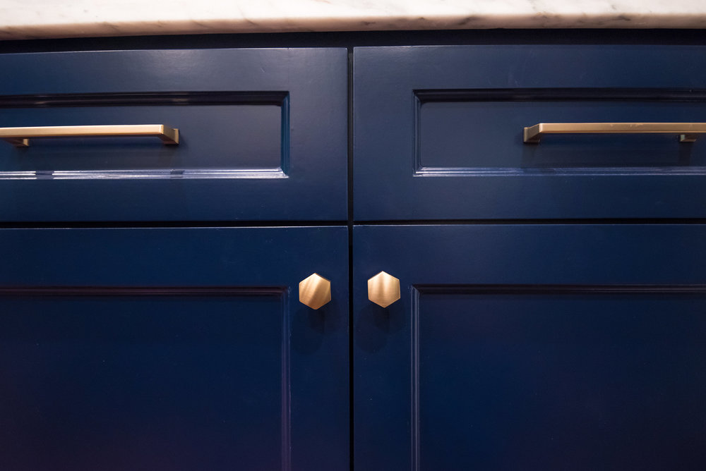 Navy cabinets with brass hardware - Carla Aston Designer, Lauren Giles Photographer