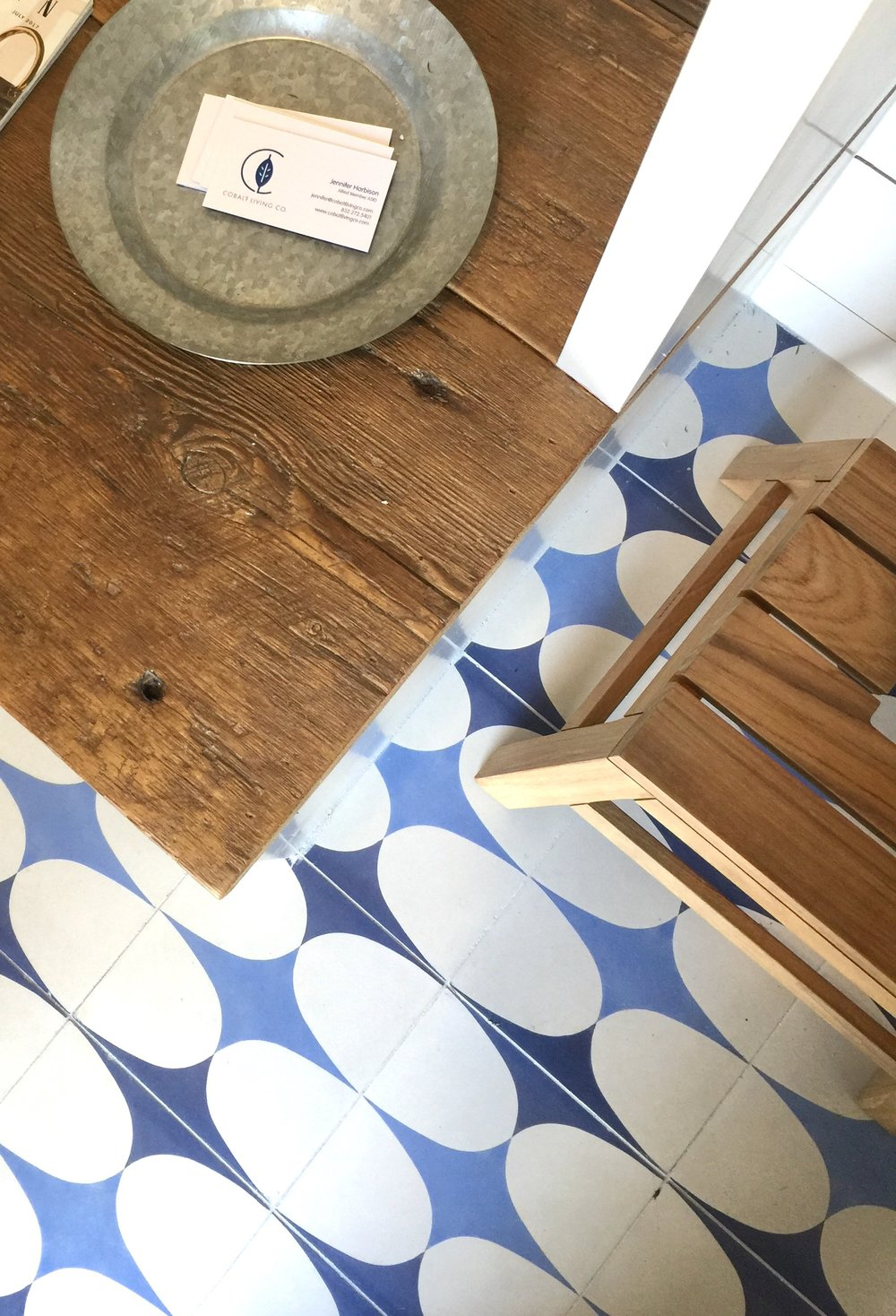 Blue and white cement tiles in the poolhouse designed by Jennifer Harbison