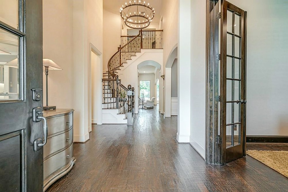 After Entry Hall with same color walls and mouldings | Carla Aston Designer