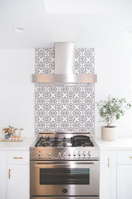 Backsplash to the ceiling at kitchen range hood | Image via: Scout Design Group