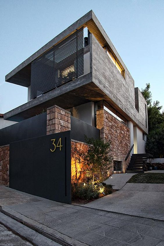 Natural stone on exterior with black wood