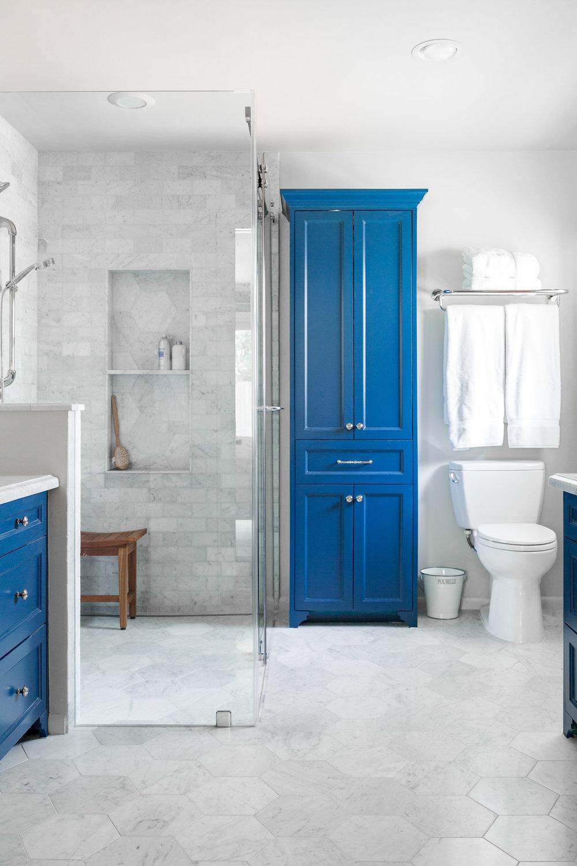 Beautiful Carrara marble bathroom remodel with blue cabinetry Carla Aston Designer Tori Aston