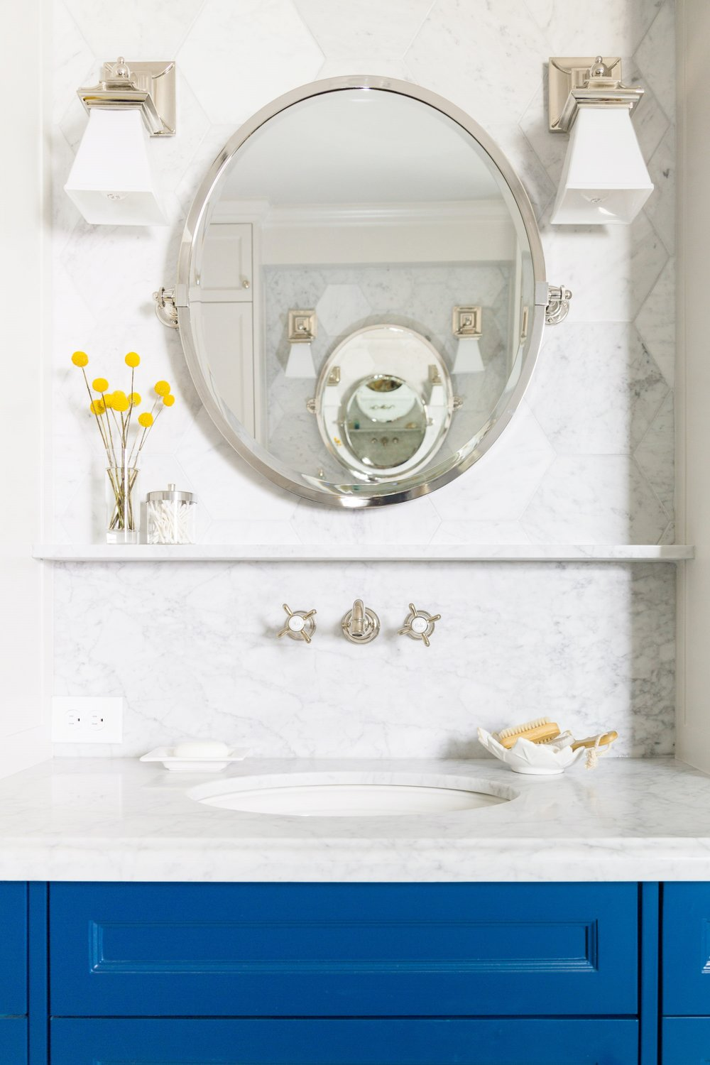 Wall mount faucet and marble ledge in bathroom remodel | Carla Aston, Designer | Tori Aston, Photographer