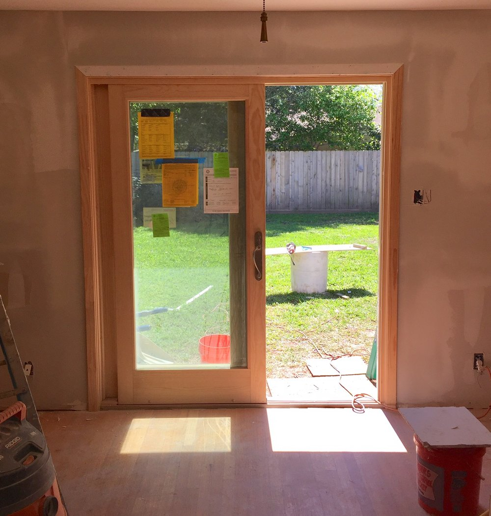 French door slider installed on back wall replacing high window