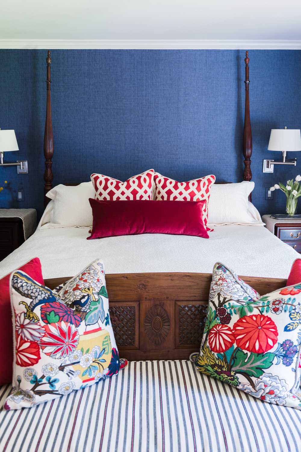 Master bedroom with navy grasscloth and Chiang Mai Dragon fabric pillows | four poster bed | Designer- Carla Aston, Photographer- Tori Aston