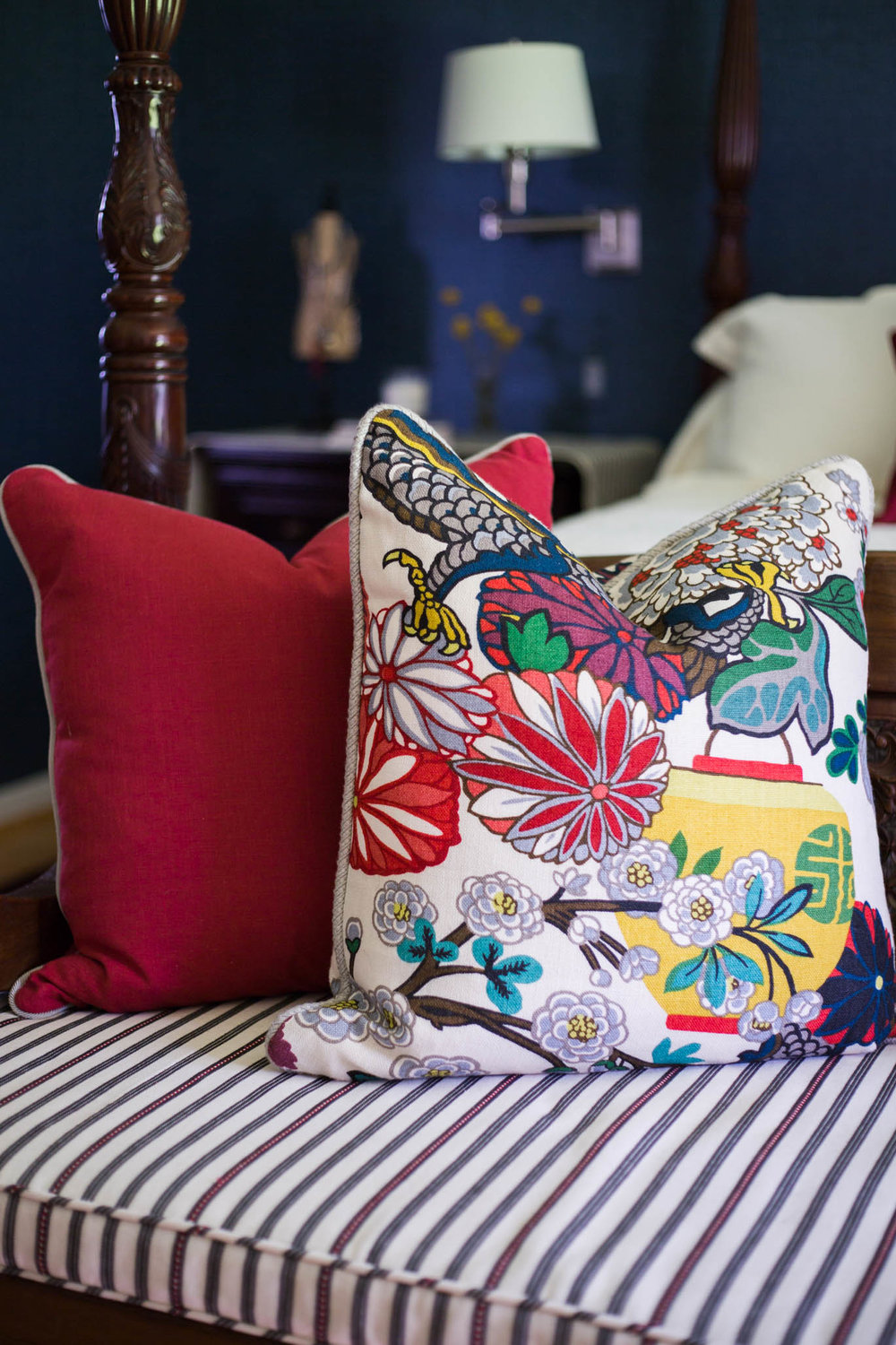 Red, white, and blue pillows with Chiang Mai Dragon fabric in bedroom makeover | Designer- Carla Aston, Photographer- Tori Aston  #grasscloth #fourposterbed #chiangmai #chinoiserie