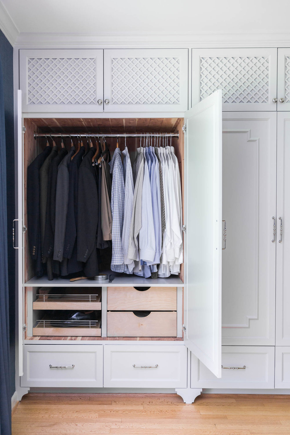 Master bedroom closet in cabinetry | Designer- Carla Aston, Photographer- Tori Aston #wardrobecloset #customcabinetry #closet