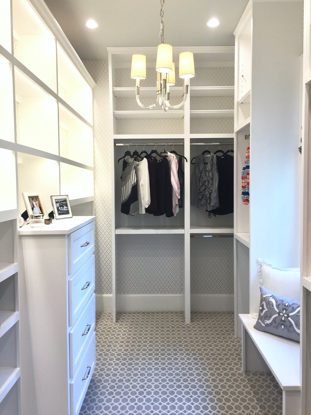 Southern Living Showcase Home - Custom closet with built-in cabinetry