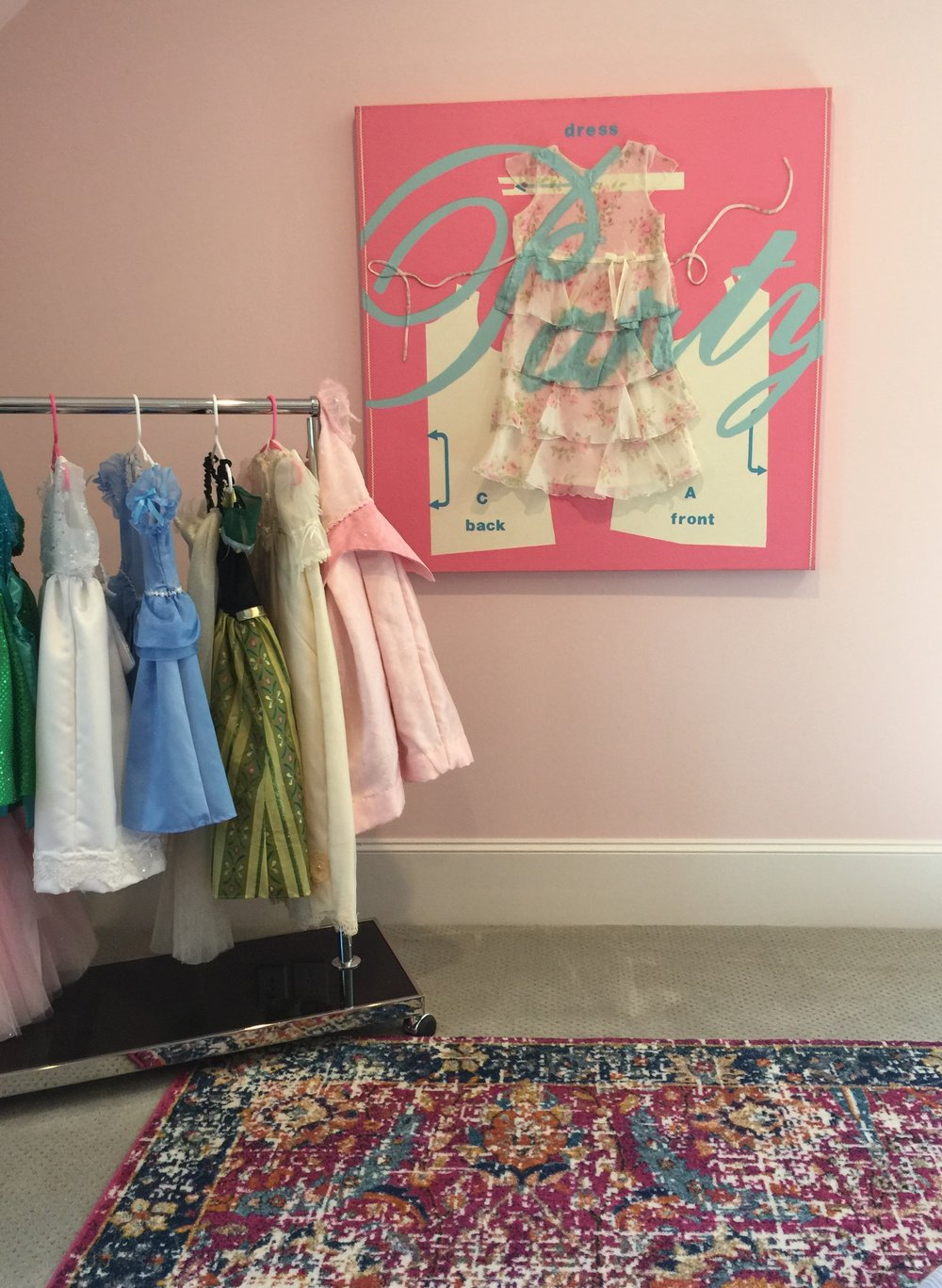 Fun girl's dress up area with custom wall art - Southern Living Showcase Home