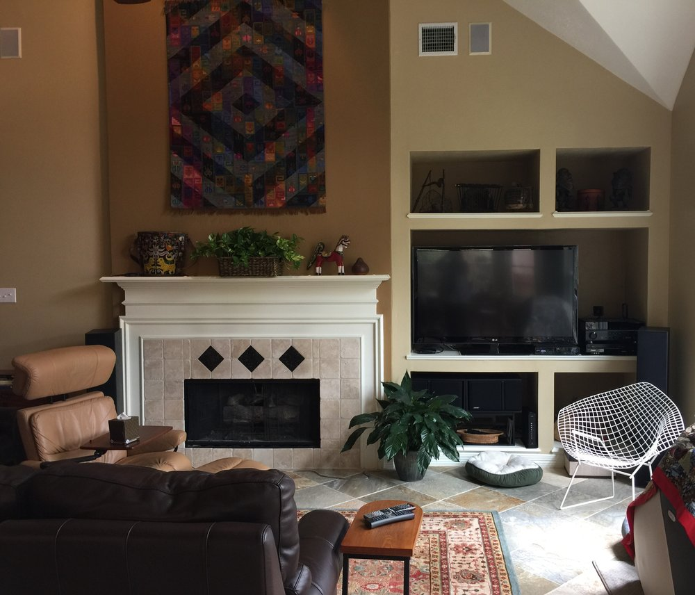 BEFORE - Fireplace wall with deep, outdated niche for tv