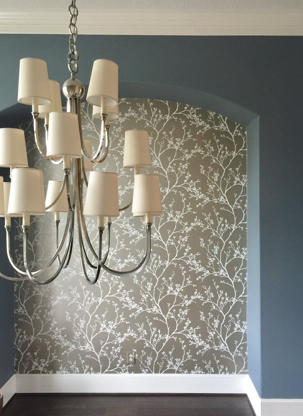 Wallcovering installed, light fixture changed out, new paint color customizes the dining room. #diningroom #chandelier #wallpaper