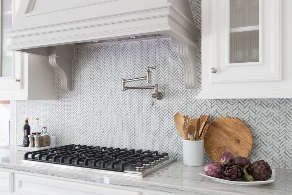 Small herringbone mosaic tile kitchen backsplash | Carla Aston, Designer | Tori Aston, Photographer