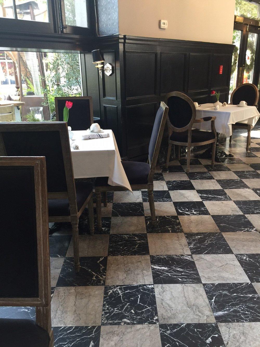 Marble checkerboard floor with black paneled walls - The Culver Hotel, Los Angeles