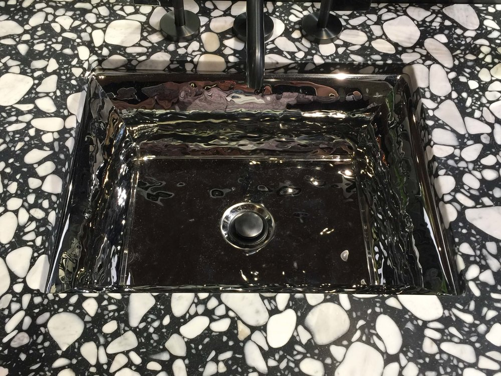Terrazzo countertops from Ann Sacks with a Kallista polished metallic sink #terrazzo